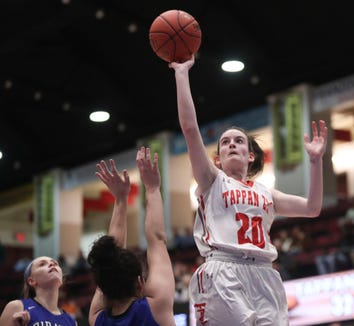 Tappan Zee's Kaleigh Beirne (20) puts up a shot late in the girls class A semifinal game at the Westchester County Center in White Plains on Tuesday, February 26, 2019.