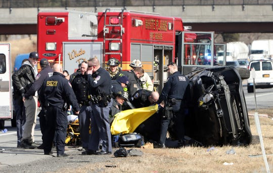 Police, firefighters and EMS respond to a rollover accident on I-287 Feb. 26, 2019 in White Plains.