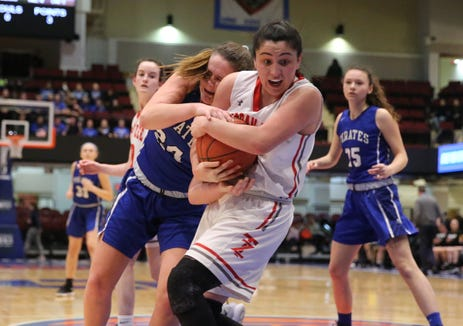 Tappan Zee's Alanis Diaz (23) and Pearl River's Ashley Rilley (24) fight for possession during the girls class A semifinal game at the Westchester County Center in White Plains on Tuesday, February 26, 2019.