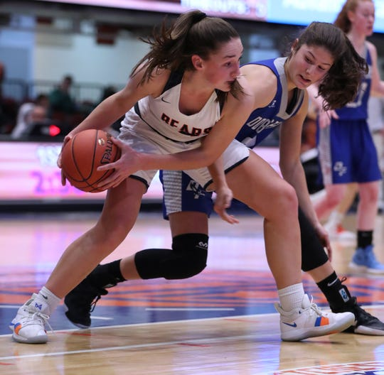 Briarcliff's Kelly O'Donnell is pressured by Dobbs Ferry's Julia Schwabe during their Section 1 Class B semifinal at the Westchester County Center Feb. 25, 2019. Briarcliff won 58-54.