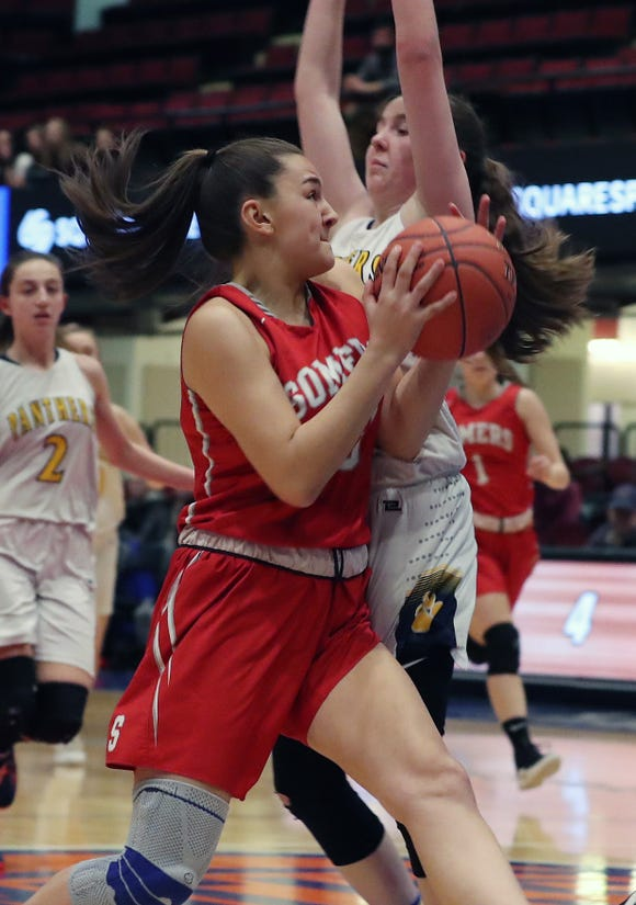 Somers' Jordan May (13) drives to the basket in front of Panas' Cailean Nolan (3) during the girls Class A basketball playoff action at the Westchester County Center in White Plains  Feb. 25,  2019. Somers won the game 39-27.