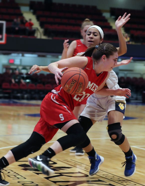 Somers' Hannah Angelini (20) drives to the basket in front of Panas'  Kat Reynoso (12) during the girls Class A basketball playoff action at the Westchester County Center in White Plains  Feb. 25,  2019. Somers won the game 39-27.