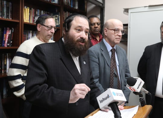 Rockland County Legislator Aron Wieder speaks about issue of public and private school equivalency at Yeshiva Degel Hatorah in Spring Valley Feb. 26, 2019. Behind him are teachers from the school.