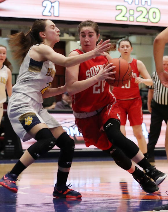 Somers' Hannah Angelini (20) drives to the basket in front of Panas' Kristen Cinquina (2) during the girls Class A basketball playoff action at the Westchester County Center in White Plains  Feb. 25,  2019. Somers won the game 39-27.