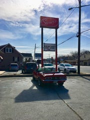 "The cherry red 1968 Camaro belonging to Guy Fieri, host of Food Network's ""Diners, Drive-ins and Dives,"" parked outside Stoney's Pub on Concord Pike Tuesday."
