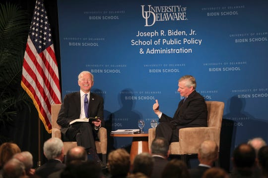 Joe Biden, left, and presidential historian Jon Meacham speak during an event at the University of Delaware on Feb. 26, 2019.