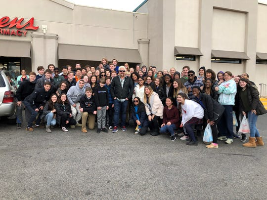 "A News Journal reader sent a photo Tuesday of Food Network star Guy Fieri posing with fans outside of Maiale Deli and Salumeria on Lancaster Pike in Wilmington. Fieri was filming a segment of his TV series ""Diners, Drive-ins and Dives."""