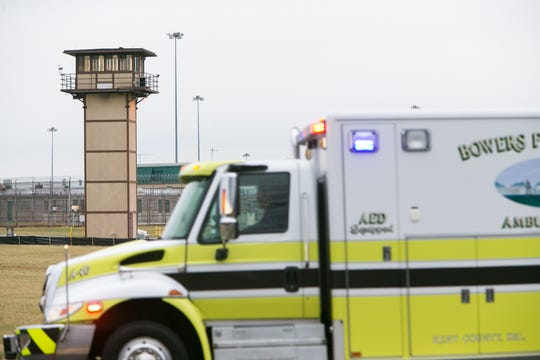 An ambulance responds to Vaughn Correctional Center near Smyrna.