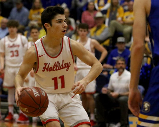 Holliday's Logan Swiatak dribbles in the playoff against Brock Monday, Feb. 25, 2019, in Graham.