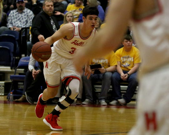 Holliday's Jett Johnson drives to the basket against Brock Monday, Feb. 25, 2019, in Graham.