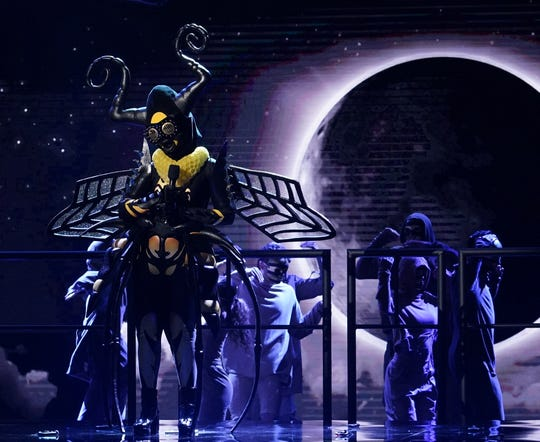 Bee, later revealed to be Gladys Knight, performs in Wednesday's finale of Fox's 'The Masked Singer.' She finished third in the hit competition.