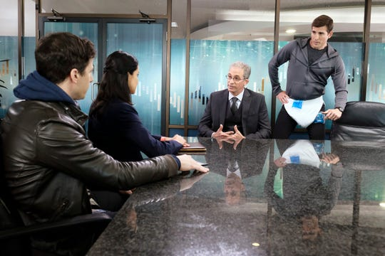 Police officers Jake (Andy Samberg), left, and Amy (Melissa Fumero), talk to a company official and a sexual assault suspect who's wearing a diaper because of a broken penis in NBC's 'Brooklyn Nine-Nine.' (Photo: Trae Patton, NBC)