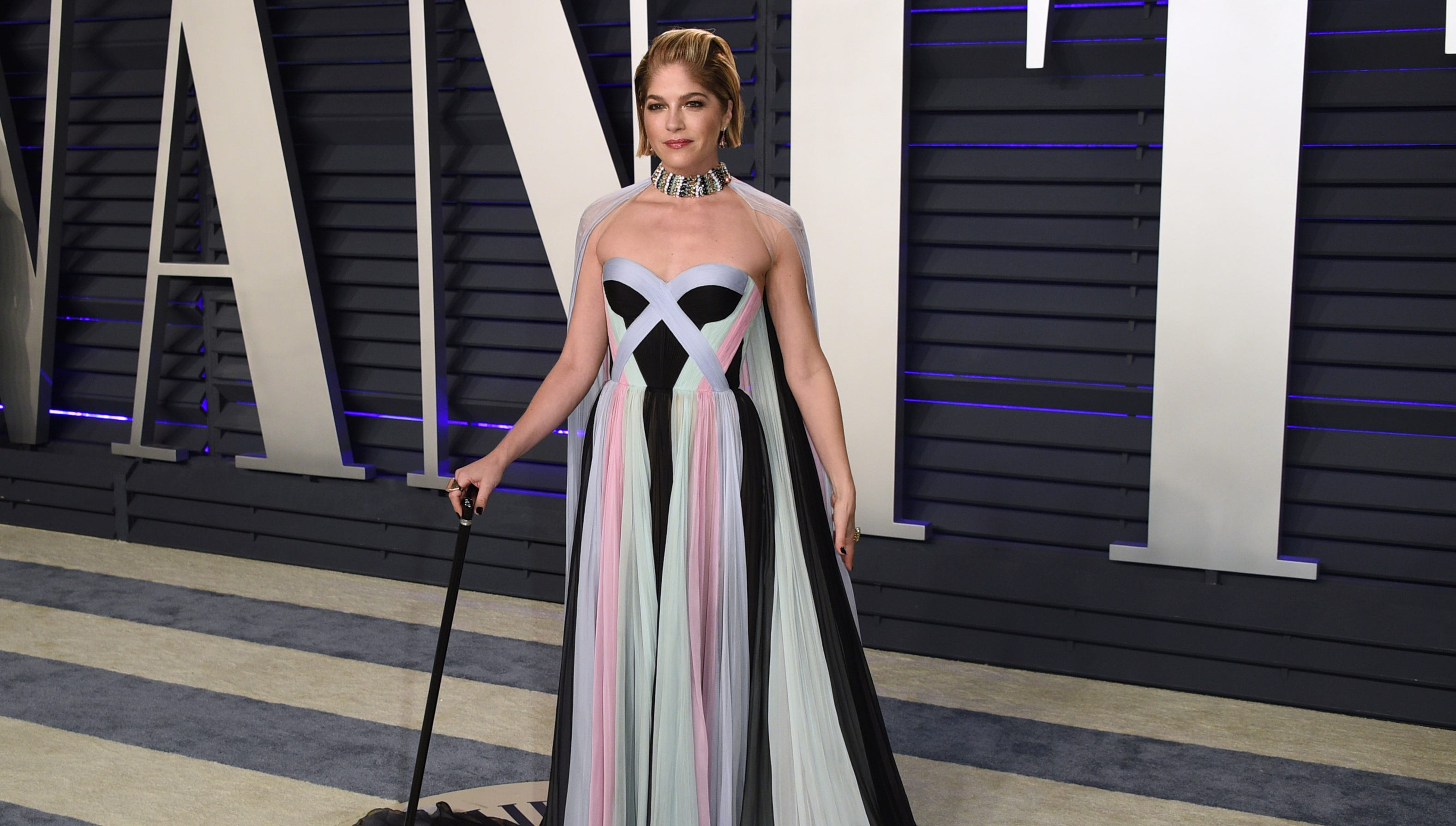 Selma Blair made her red-carpet return – complete with a glam cane –  at this year's Vanity Fair Oscar party.