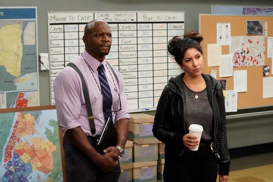"Sgt. Terry Jeffords (Terry Crews), left, was racially profiled in a Season 4 episode of ""Brooklyn Nine-Nine"" and Detective Rosa Diaz (Stephanie Beatriz) came out as bisexual to her parents during Season 5. (Photo: Evans Vestal Ward, NBC)"