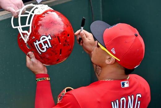 Feb. 25: St. Louis Cardinals second baseman Kolten Wong signs autographs before a game against the Detroit Tigers at Roger Dean Chevrolet Stadium.