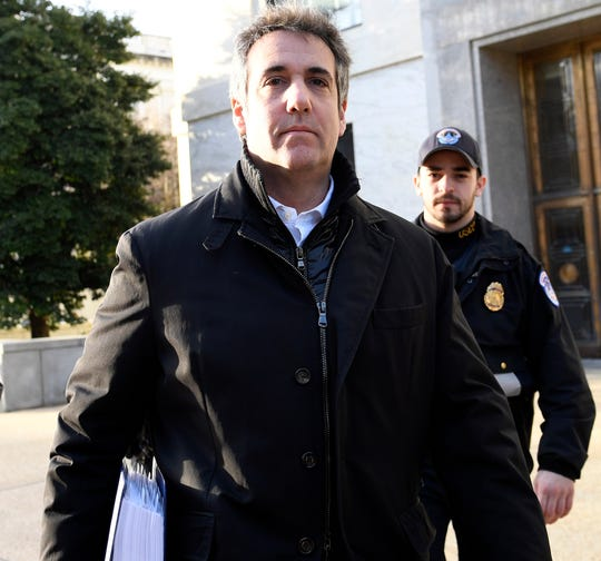 Michael Cohen, President Donald Trump's former personal attorney, is pictured leaving Capitol Hill in Washington.