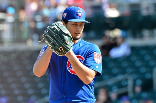 Cubs starter Yu Darvish pitches Tuesday during a spring training game against the Diamondbacks.