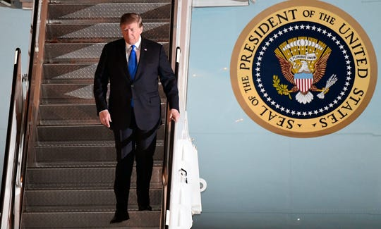 President Donald Trump walks off Air Force One at Noi Bai International Airport on arrival, in Hanoi, Vietnam, Feb. 26, 2019, ahead of his second summit with North Korea's Kim Jong Un.
