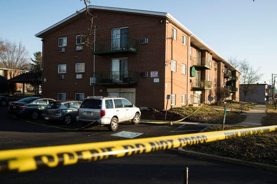 Crime scene tape surrounds the Robert Morris Apartments in Morrisville, Pa., on Feb. 26, 2019. A woman and her teenage daughter are facing homicide charges in the deaths of five relatives, including three children, inside an apartment at the complex in suburban Philadelphia, according to authorities.