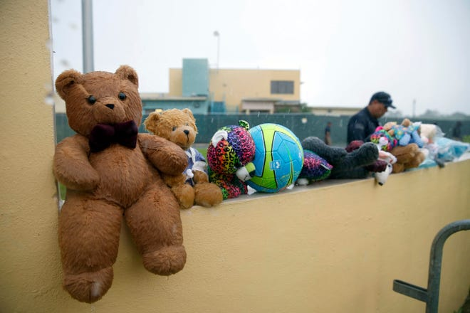 A guard walks by toys placed for migrant children.