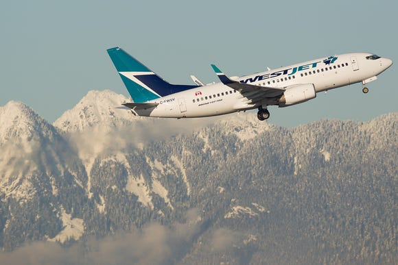 A WestJet Boeing 737-700 takes off from Canada's Vancouver International Airport in December 2016.