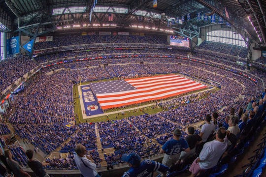 A field-sized American flag used during the national anthem before an NFL game.