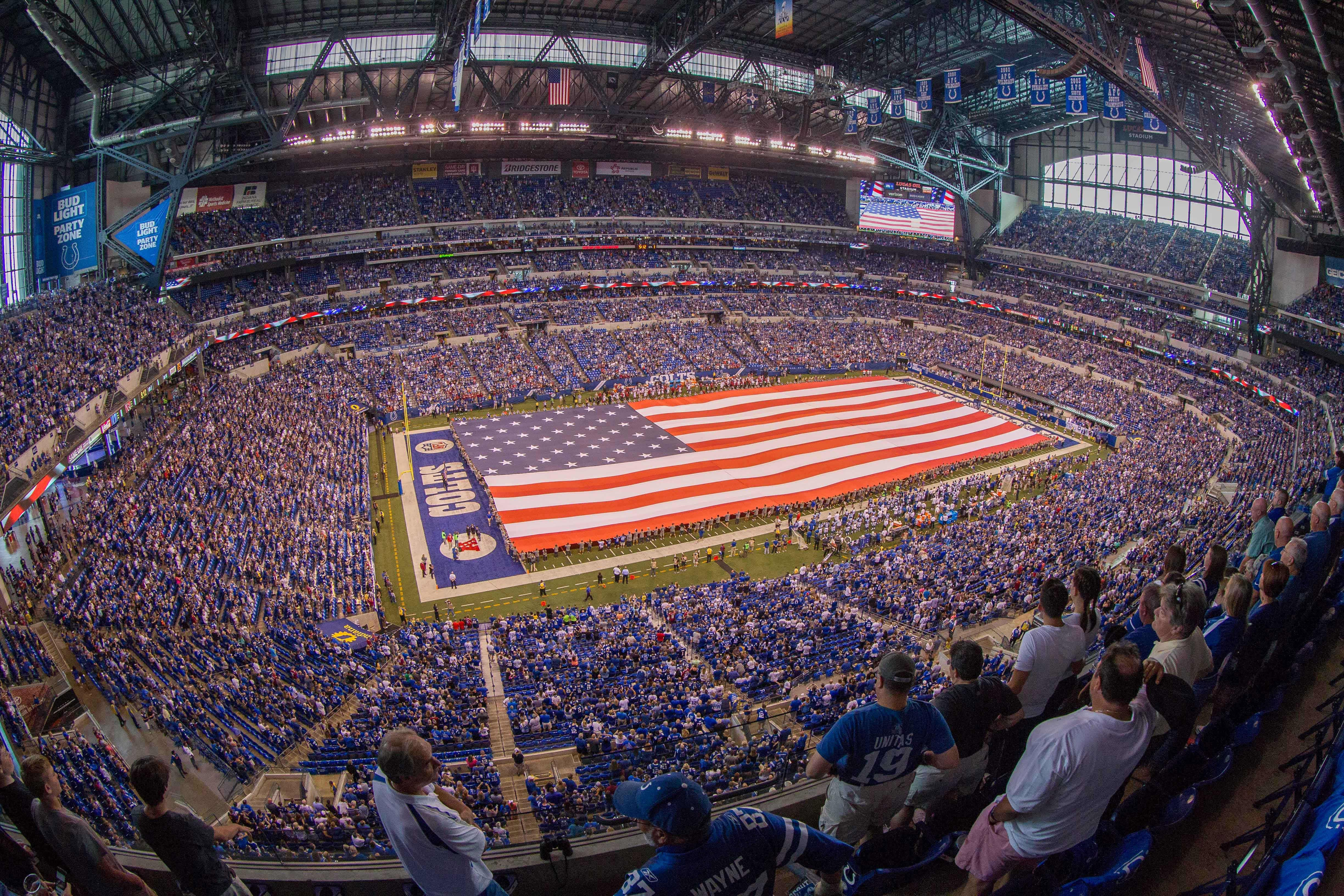 A field-sized American dwindle used during a inhabitant anthem before an NFL game.