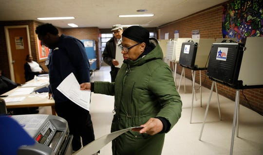 Stephanie Arnold votes at the polling place inside South Shore Fine Arts Academy in Chicago on Tuesday, Feb. 26, 2019.