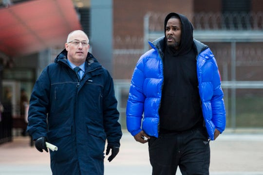 R. Kelly walks out of Cook County Jail with his defense attorney, Steve Greenberg, after posting $100,000 bail, Monday afternoon, Feb. 25, 2019, in Chicago.