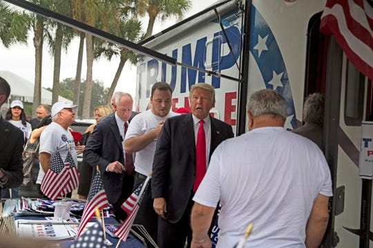Then-Republican presidential nominee Donald Trump meets supporters organizing voter registration and support for his campaign just before a rally at the Florida State Fairgrounds in Tampa, Florida, on Aug. 24, 2016.