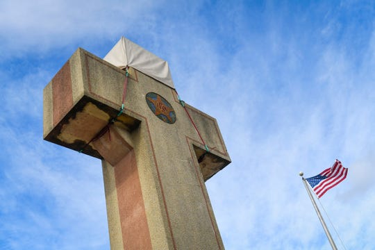 Motorists driving by the Peace Cross see  the religious aspect, but the World War I inscription is harder to fine.