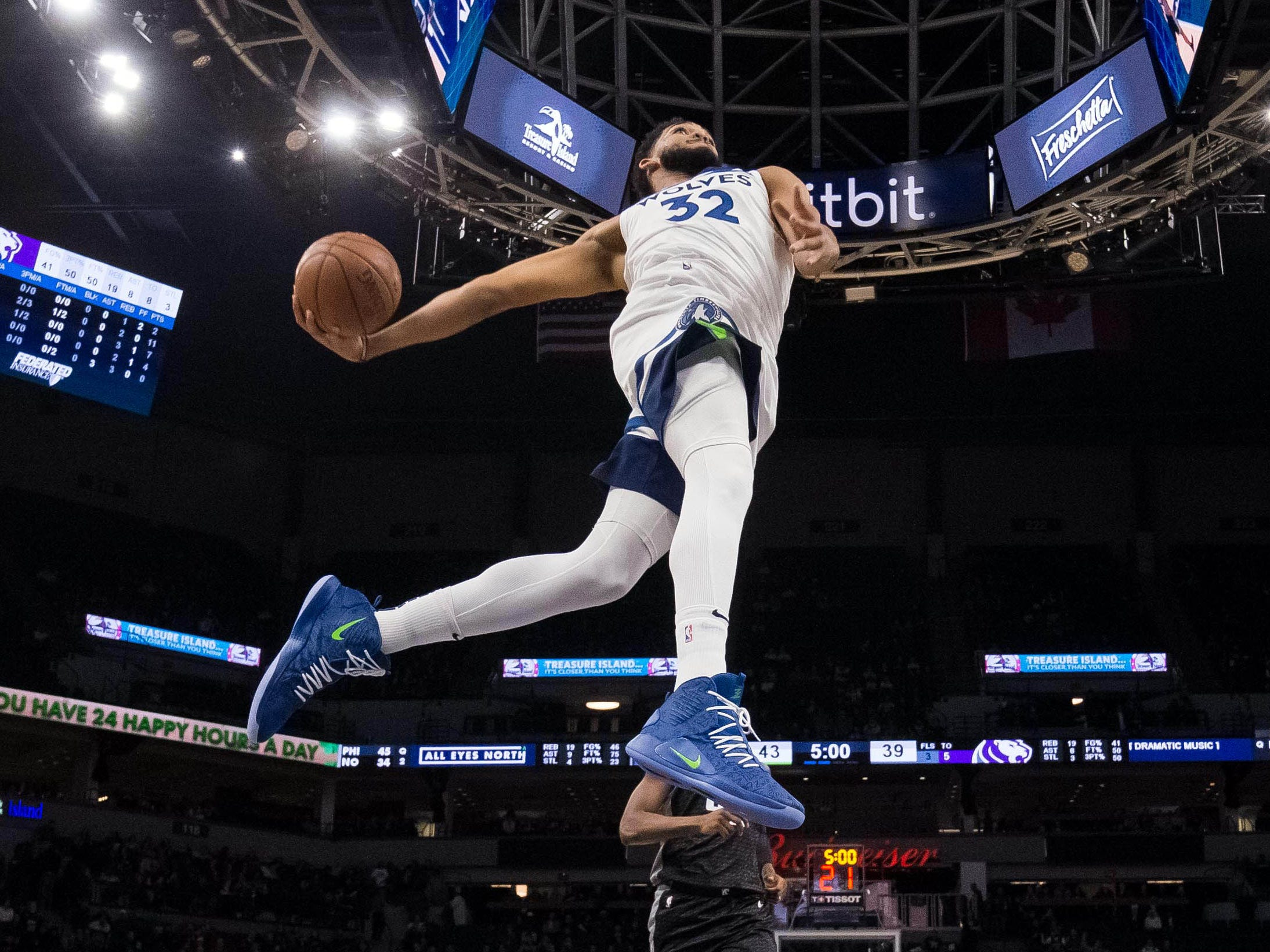Feb. 25: Timberwolves center Karl-Anthony Towns soars to the bucket for a one-handed slam on the break against the Kings.