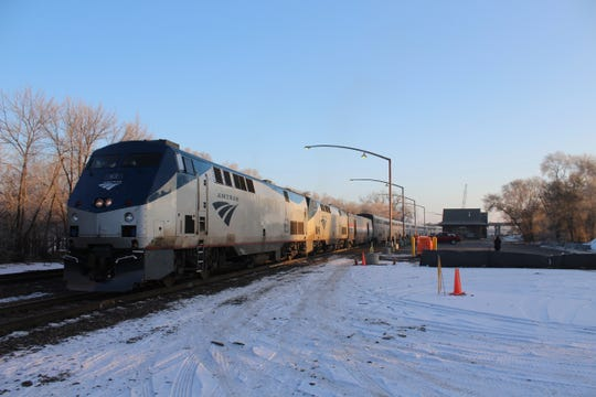 In this file photo, an Amtrak train heads to Oregon. Amtrak said it is trying to get to passengers stranded on a train in Oakridge, Oregon, since Sunday night.