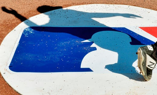 Feb 23: A Pirates player casts a shadow as they warm up before a spring game.
