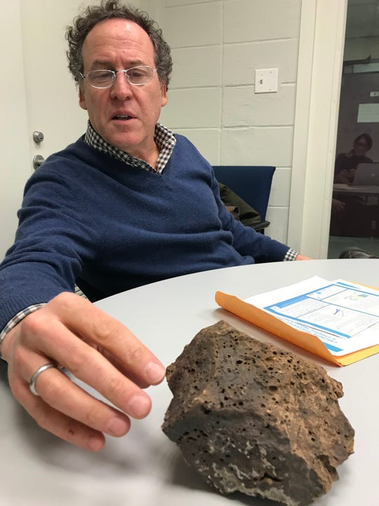 David Goldberg, a marine geology professor at Columbia's Lamont-Doherty Earth Observatory in Palisades, New York, with a piece of porous basalt. He's proposed a test that would pump 10,000 metric tons of carbon dioxide 1,000 to 2,000 feet down below the ocean floor off the Pacific Northwest coast. Iceland already has a similar pilot project up and running.