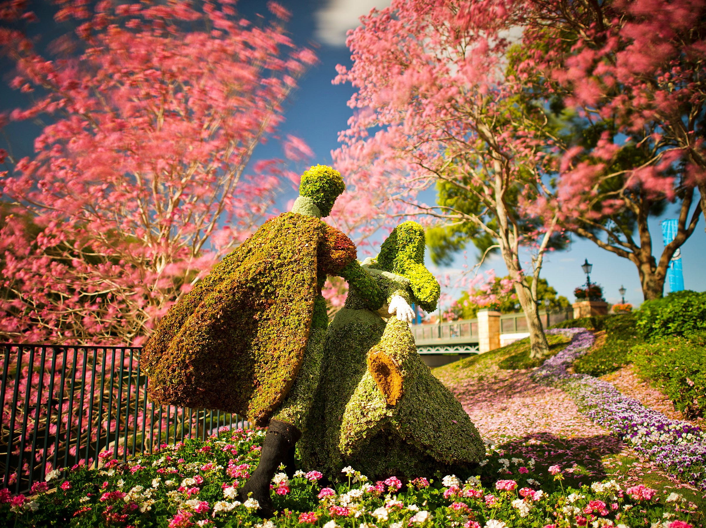 10 GREAT GARDENS- Richly-hued flowers adorn the Epcot International Flower & Garden Festival. The festival, which runs 75 days March 6-May 19, 2013, at Walt Disney World Resort in Lake Buena Vista, Fla., features dozens of character topiaries, stunning floral displays, workshops, the Flower Power concert series and presentations by HGTV personalities - all included in regular Epcot admission.  HANDOUT Photo by Matt Stroshane, Disney [Via MerlinFTP Drop]