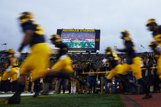 The Wolverines take the field at Michigan Stadium prior to a game against the Indiana Hoosiers.