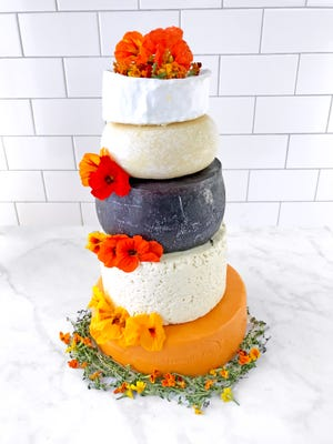 A wedding cake made of nothing but cheese.