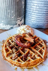 A house-made cinnamon granola waffle topped with apples from Project Brunch, opening this summer in Manalapan.