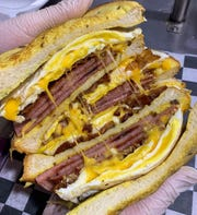 The Super Tsunami at Joe's Bagel in Brick is a triple-decker sandwich made with six pieces of pork roll, four eggs and three slices of bacon on French toast.