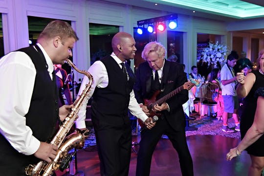 Mission Dance, including founding guitarist Lee Deedmeyer, right, performs at a wedding.