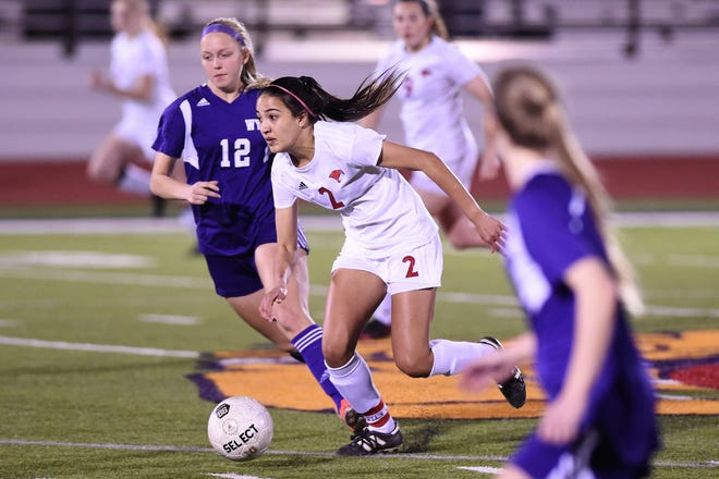 Cooper's Hayden Abor (2) carries the ball against Wylie at Bulldog Stadium on Tuesday, Feb. 26, 2019. Abor scored the lone goal as the Lady Cougars won 1-0.