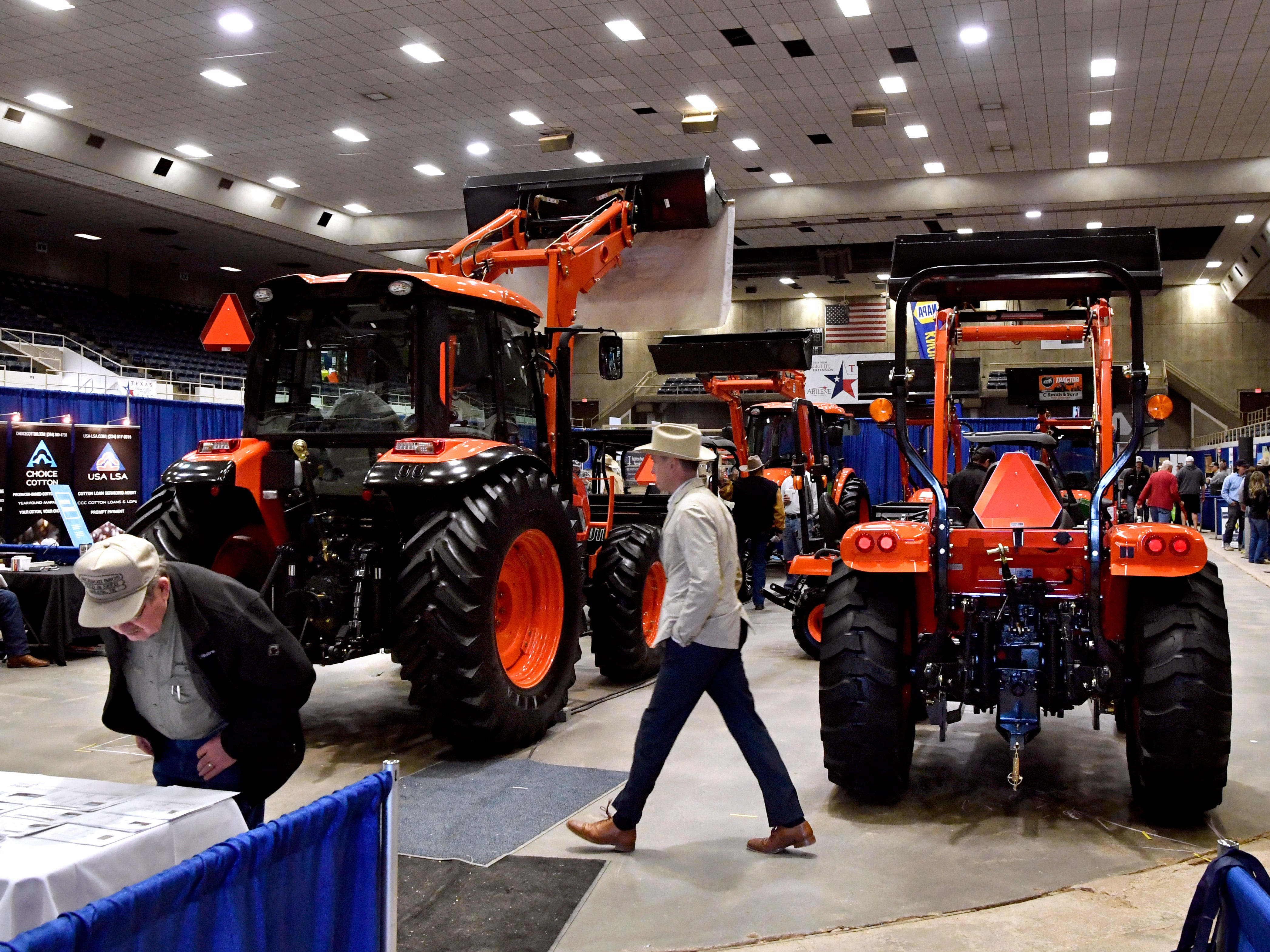 Attendees walk past farm equipment during the Farm-Ranch-Wildlife Expo Feb. 20, 2019. The two-day event was held at the Taylor County Expo Center.