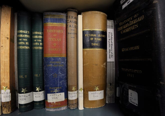Books sit on a shelf in the Genealogy and Local History Branch of the Brownwood Public Library.