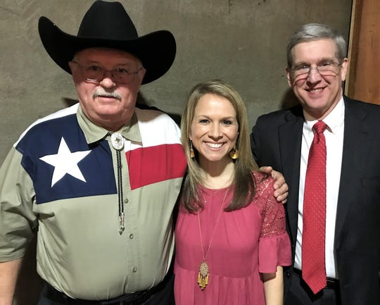 From left, Jack Rentz (who would not take off his new cowboy hat), Katie Alford and Ray Ferguson were honored Tuesday for their work with Junior Achievement of Abilene.