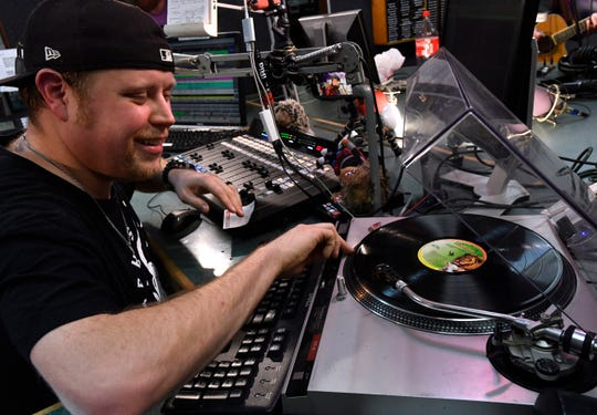 Dustin Tatro cues a vinyl record during his show on KGNZ radio Feb. 13.