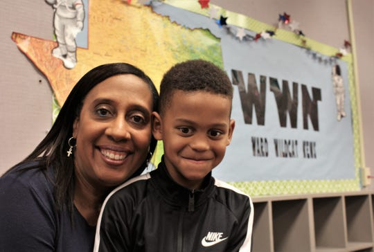 Kari Leong with her grandson, KIngston Leong Brown, a kindergartener at Ward Elementary School. She recently was the guest star of the school's announcement program.