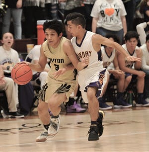 Jayton's Aaron Hernandez, left, brings the ball upcourt while Munday's Jojo Hernandez defends. Jayton beat the Moguls 53-49 in the Region II-1A quarterfinal playoff game Tuesday, Feb. 26, 2019, at McMurry's Kimbrell Arena.
