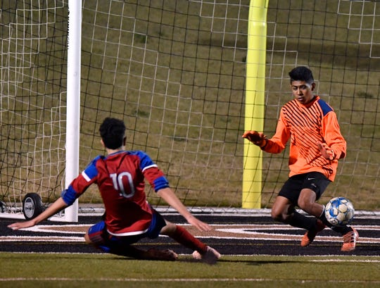 Cooper High's John Scaief kicks the ball into the net past Wylie goalkeeper Victor Charo during Tuesday's crosstown soccer match at Shotwell Stadium Feb. 26, 2019.