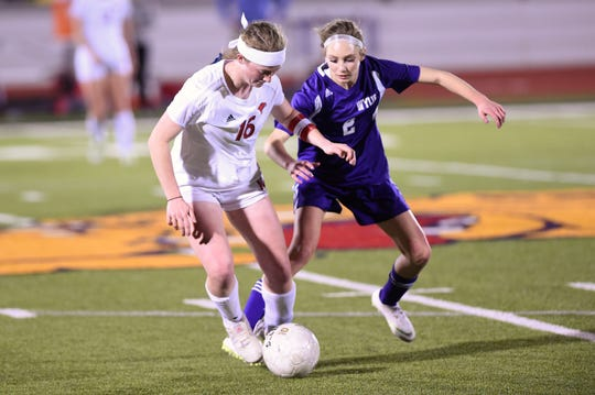 Cooper's Caylee Collier (16) protects the ball from Wylie's Morgan Travis (2) at Bulldog Stadium on Tuesday, Feb. 26, 2019. The Lady Cougars won 1-0.